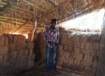 Patrick with some of the drying bricks he has made for the construction of a widow's home.