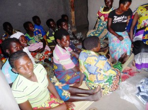 Pregnant ladies witnessing the handing over of Birthing kits to the health center where they go for antenatal care.