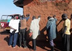 YWAM Arua team praying for the Health Clinic