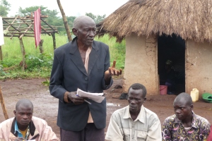 Grandpa speaking at a community meeting in rural Jalasiga village