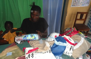 Redefined office assistant, Mrs. Pauline Ani preparing D4G kits to be taken in the field